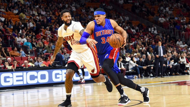 Pistons forward Tobias Harris drives to the basket as Heat forward James Johnson defends in the first half Sunday, Jan. 1, 2017 in Miami.