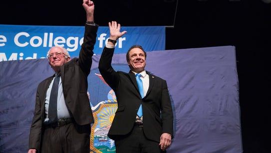 New York Gov. Andrew Cuomo, right and Vermont Sen.