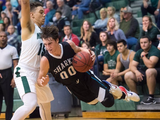Gulf Coast's Bryce Foggin loses his footing as he hurdles to the floor as Lakewood Ranch High School takes on Gulf Coast High School for the Class 8A-Region 3 boys basketball quarterfinals on Thursday evening, February 16, 2017 in Lakewood Ranch.