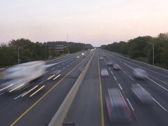 Cars speed along the New Jersey Turnpike near exit 5 in Mount Holly.