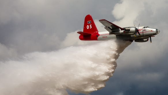 Tanker 05, a Lockheed P-2 Neptune fire tanker, makes
