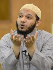Imam Mohamed Zakarya talks about Islam during an open house at the Islamic Society of Wisconsin Green Bay Mosque.