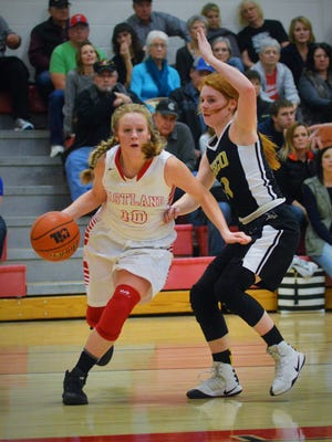 Eastland's Hailee Stacy, left, tries to drive around Cisco's Hallie Taylor in the in the first quarter of their game this season in Eastland.
