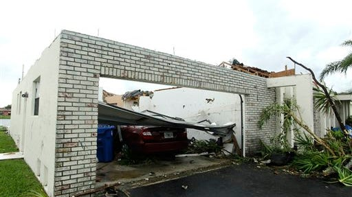 This October 2011 file photo shows a damaged house in Sunrise, Fla. after a possible tornado damaged more than two dozen houses in the area. Oklahoma and Kansas may have the reputation as tornado hotspots, but Florida and the rest of the Southeast are far more vulnerable to killer twisters, a new analysis shows.