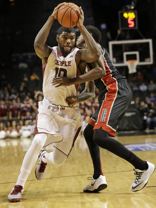 UNLV's Dwayne Morgan, right, fouls Temple's Mark Williams during the first half of an NCAA college basketball game for third place in the Coaches vs. Cancer Classic, Saturday, Nov. 22, 2014, in New York. (AP Photo/Seth Weng)