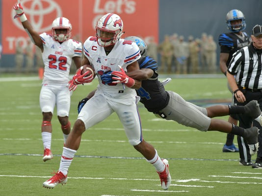 SMU wide receiver Courtland Sutton (16) carries the ball against Memphis defensive back Tito Windham (24) in the first half of an NCAA college football game Saturday, Nov. 18, 2017, in Memphis, Tenn. (AP Photo/Brandon Dill)
