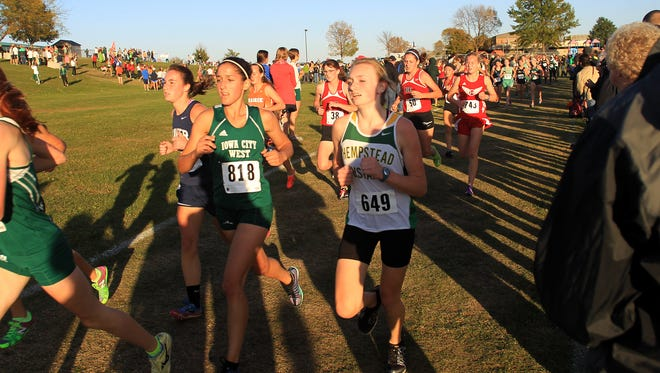 West High's Tia Saunders runs with the pack during the MVC cross country super meet at Cedar Rapids Prairie on Thursday, Oct. 9, 2014.   David Scrivner / Iowa City Press-Citizen