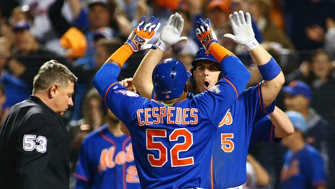 Yoenis Cespedes and David Wright celebrate after Cespedes' three-run home run.