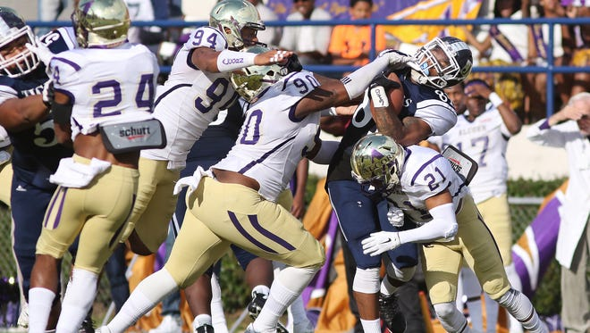 Quinton Cantue (21), Kenyon Brantley (90) and Michael Brooks Jr. (94) are part of an Alcorn State defense that has given up 33 points in the past three games.