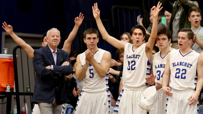 The Blanchet bench celebrates a play behind coach Scott Cantonwine in the Colton vs. Blanchet boy's basketball game at Blanchet Catholic School in Salem on Tuesday, Feb. 9, 2016.