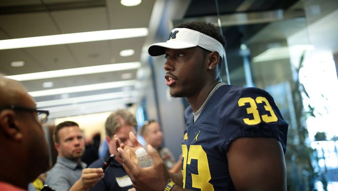Michigan's Taco Charlton (33) speaks to reporters during U-M media day Sunday, August 7, 2016, at Michigan Stadium in Ann Arbor.