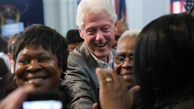 (left to right) Elizabeth Sanders, of Flint, Geraldine Feaster, of Flint, and Regina Kelly, of Flint, pose for a photo with President Bill Clinton after he spoke during the Michigan Democratic Party Flint Stronger Together Rally at the Northbank Center in downtown Flint on Monday October 3, 2016.
