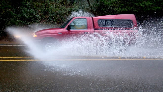 A truck drives through high water on Croisan Creek Road S in Salem last year. A flood watch has been issued for the Willamette Valley for Tuesday through Thursday as snow melts and heavy rain is predicted.