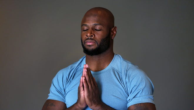 Indianapolis Colts safety Mike Adams works during a private yoga session with Darya Bowskill, not pictured, at Simply Yoga in Zionsville, Tuesday, November 29, 2016.