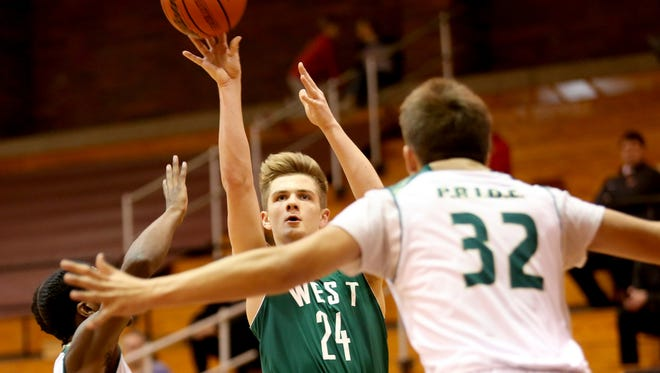 West Salem's Zac Bulgin (24) shoots the ball against Evergreen in the recent Capitol City Classic at Willamette University.