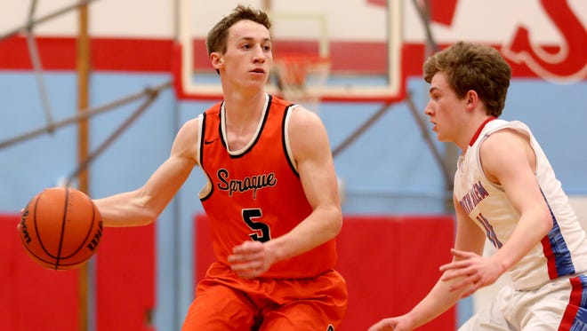 Sprague's Kaiden Flanigan (5) moves around South Salem's Tyler Wadleigh (11) in the second half of the Sprague vs. South Salem boy's basketball game at South Salem High School on Friday, Feb. 3, 2017. Sprague won the game 64-58.