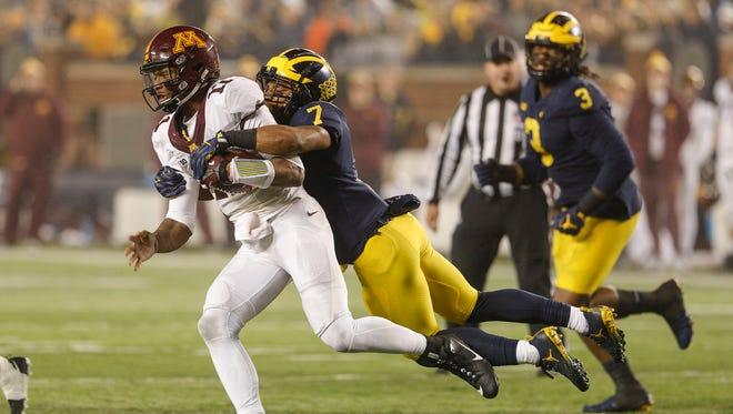 Michigan's Khaleke Hudson (7) sacks Minnesota quarterback Demry Croft (11) during the second half at Michigan Stadium in Ann Arbor, Saturday, November 4, 2017.