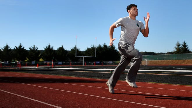 Anthony Gould, a junior football recruit and one of the top track sprinters in the state, at West Salem High School on Tuesday, March 20, 2018.