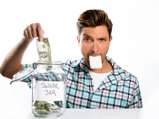 Man paying a swear jar