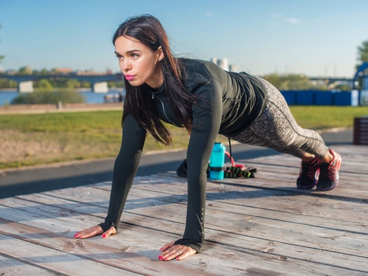 Fit woman doing full plank core exercise fitness training  working