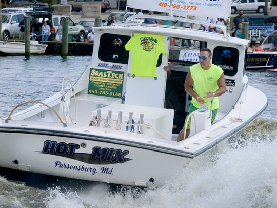 Jeff Brown navigates his boat, Hot Mix, into the docks
