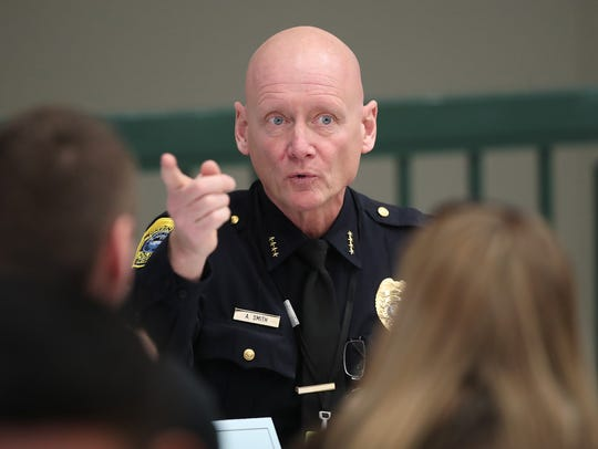 Green Bay Police Chief Andrew Smith speaks to those