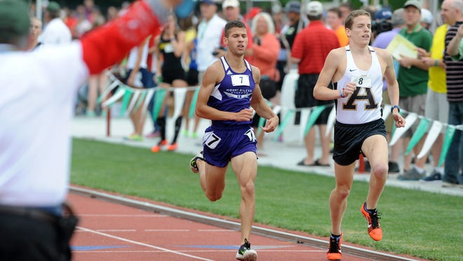 Mount Gilead's Austin Hallabrin, left, runs the 1,600-meter run during the Division III state final Saturday at Jesse Owens Memorial Stadium in Columbus.