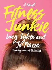 """This image released by Doubleday shows """"Fitness Junkie,"""" a novel by Lucy Sykes and Jo Piazza, available on July 11."""