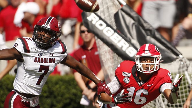 Georgia wide receiver Demetris Robertson (16) tries to pull in a pass from Georgia quarterback Jake Fromm (11) while being defended by South Carolina defensive back Jammie Robinson (7) in the first half of a NCAA football game between Georgia and South Carolina in Athens, Ga., on Saturday, Oct. 12, 2019.