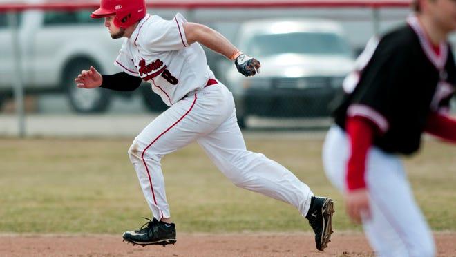 Port Huron's Austin Schneider runs for third base during a baseball game Tuesday, April 7, 2015 at Port Huron High School.