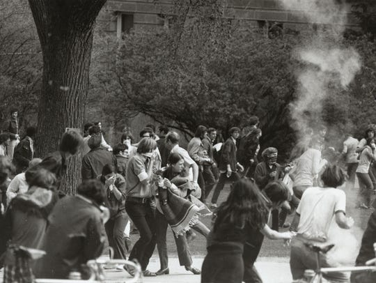 Protestors react to tear gas on the UW campus, May