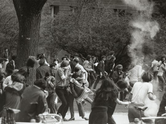 Protestors react to tear gas on the UW campus, May 1970.
