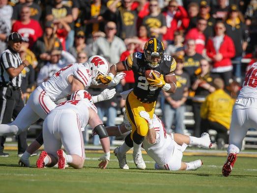 Iowa running back LeShun Daniels, Jr., runs the ball