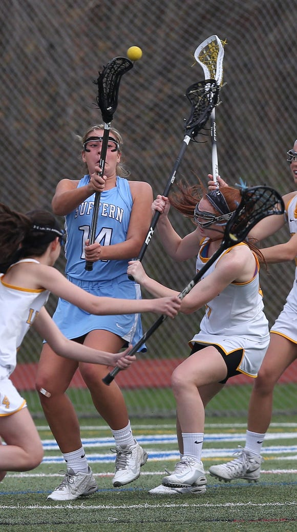 Suffern's Reilly Drab (14) gets off a shot while surrounded