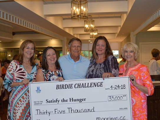 Geri Walker (third from left), president of MGCC Board of Directors, and Kitty Wildman (far right), MGCC Membership Director, last month present a $35,000 check to the Naples Daily News from for its Satisfy The Hunger campaign. From left, Robin Lankton, former Daily news client strategy director, Fran Reiss (second from left),