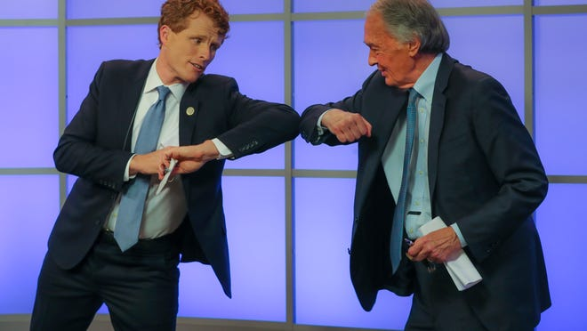 Rep. Joe Kennedy III, left, elbow-bumps Sen. Edward Markey after their debate for the Democratic primary for senator from Massachusetts, Monday, June 1, 2020, in Springfield, Mass.