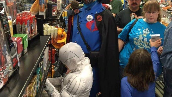 Costumed customers pack the aisles of Mayhem Comics in Clive, which has been in business since 1998.