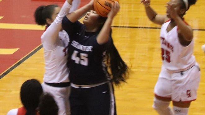Shawnee's Esabelle Ramirez (45) goes up for a basket against Carl Albert Tuesday night.     PHOTO BY BRIAN JOHNSON