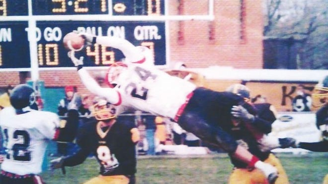 Future City of Ravenswood Mayor Josh Miller, No. 24, makes an incredible catch during his Red Devil high school football career.