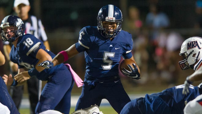 Jackson Academy running back Tosh McGee runs for yards against MRA in a 10-7 loss on Friday.