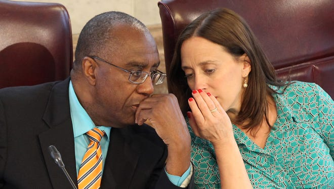 Budget and finance committee chair Charlie Winburn, left, talks with vice chair Amy Murray during a committee meeting.