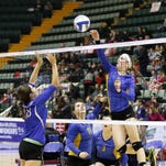 Martha Schumacher of Tioga goes up for a spike as Haldane's Catherine Parr watches during their pool-play match Saturday at the Class D girls volleyball final four at the Glens Falls Civic Center.
