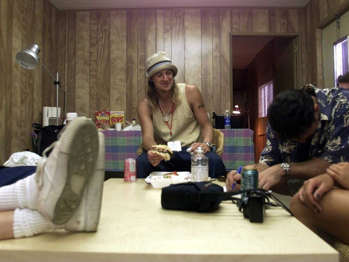 Kid Rock grabs a quick bite before going on stage at
