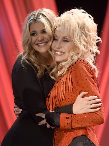 Lauren Alaina and Dolly Parton pose for photos during