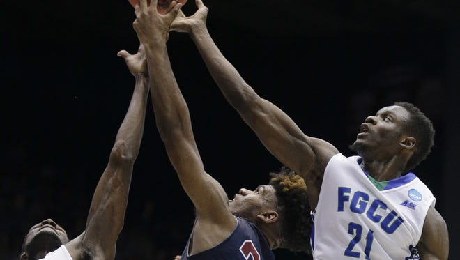 AP Fairleigh Dickinson's Mike Holloway (34) and Florida Gulf Coast?s Demetris Morant (21) battle for a rebound in the first half of a First Four game in the NCAA  Tournament on Tuesday. Florida Gulf Coast's Marc Eddy Norelia (25), Demetris Morant (21) and Fairleigh Dickinson's Mike Holloway (34) battle for a rebound in the first half of a First Four game of the NCAA college basketball tournament, Tuesday, March 15, 2016, in Dayton, Ohio. (AP Photo/John Minchillo)