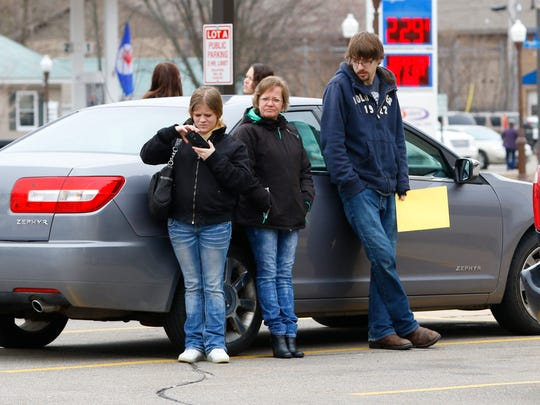 Visitors await outside Wednesday as weapon holster triggered lockdown on Marathon County Courthouse in Wausau, Wisconsin.
