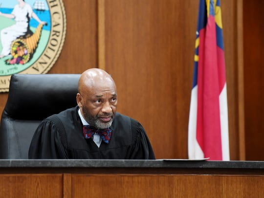 Chief District Court Judge Calvin Hill, a Candler resident and Democrat, presides over court in 2017.