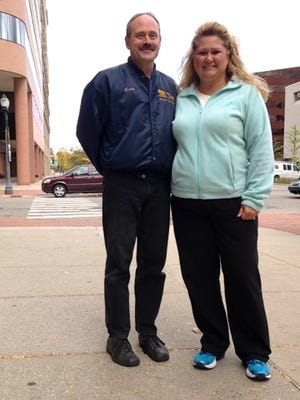 Erin Tryon, who works for the Michigan Department of Transportation, and her husband, Kevin Tryon, take a lunchtime stroll in downtown Lansing Friday, Oct. 16.