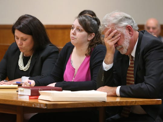 Erica Bell, center, sits flanked by her attorneys Sarah Wesley, left, and Lawrence Kasperek, right, during closing arguments in the Erica Bell murder trial in the death of three-year-old Brook Stagles, Thursday, Sept. 21, at Monroe County Court.