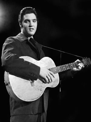 Rock'n roll legend Elvis Presley is seen during a concert in a file picture taken in the 1950's.